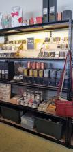 Shelf of hand made goodies at Tienda, including our CrankyBot items