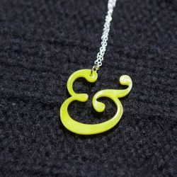 Yellow Williams Caslon Ampersand necklace